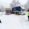 Two truck drivers look at their vehicles which bumped together and got stuck on University HIll. December 22, 2011<br /> Photo by Paul Aiken