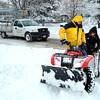 "Arturo Brionas, left, and Ivan Meza work to plow the sidewalk on South Boulder Road in Lafayette on Thursday, Dec. 22. For more photos of the storm go to  <a href=""http://www.dailycamera.com"">http://www.dailycamera.com</a><br /> Jeremy Papasso/ Camera"