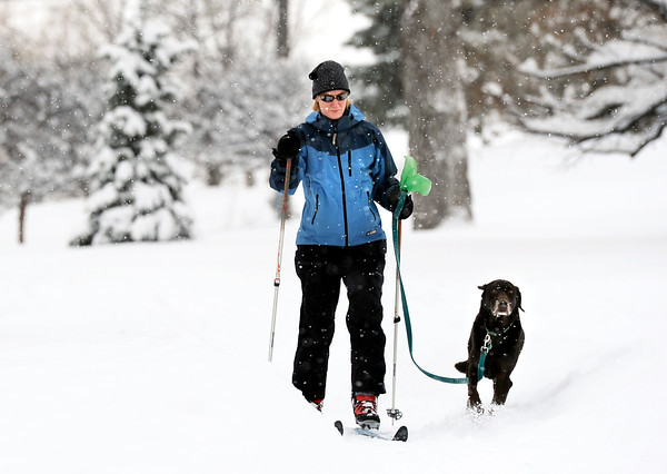 "Elizabeth Hitchcock, of Boulder, cross-county skis with her dog Toby at Tantra Park in Boulder on Thursday, Dec. 22. For more photos of the storm go to  <a href=""http://www.dailycamera.com"">http://www.dailycamera.com</a><br /> Jeremy Papasso/ Camera"