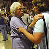 MEETING<br /> Bunny Rubin, left, and Ann Hoyt, evacuees from the Fourmile Canyon Fire, greet each other after a community meeting held Wednesday night at the Coors Event Center on the University of Colorado campus. Rubin's house is two miles up Sunshine Canyon, while Hoyt's in Pinebrook Hills. <br /> Photo by Marty Caivano/Camera/Sept. 8, 2010