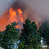 "Fire charges down the hill to Gold Hill as taken by photograper Greg Cortopassi at around 5 pm on Monday.<br /> Photos Greg Cortopassi <a href=""http://cortoimages.com"">http://cortoimages.com</a>"