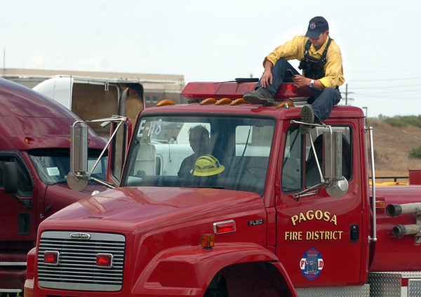 """Taro Hill of the Pagosa Fire District stops to check messages during his down time at the fire command center at the Boulder Reservoir.<br /> For  videos relating to the fire,  go to  <a href=""""http://www.dailycamera.com"""">http://www.dailycamera.com</a>.<br /> Cliff Grassmick / September 8, 2010"""