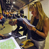 MEETING<br /> Debora Bryant, who was displaced from her home in Pinebrook HIlls by the Fourmile Canyon Fire, looks at a map of the burn area during a community meeting held Wednesday night at the Coors Event Center on the University of Colorado campus. <br /> Photo by Marty Caivano/Camera/Sept. 8, 2010
