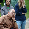 DAYTHREE<br /> Binx Selby, left, listens to a press conference about the Fourmile Canyon Fire on Wednesday. His house, which is very close to the bottom of Fourmile Canyon, is still standing. At right is Mindy Mullins, whose house is on Logan Mill Road. She still has no news on her property. <br /> Photo by Marty Caivano/Camera/Sept. 8, 2010