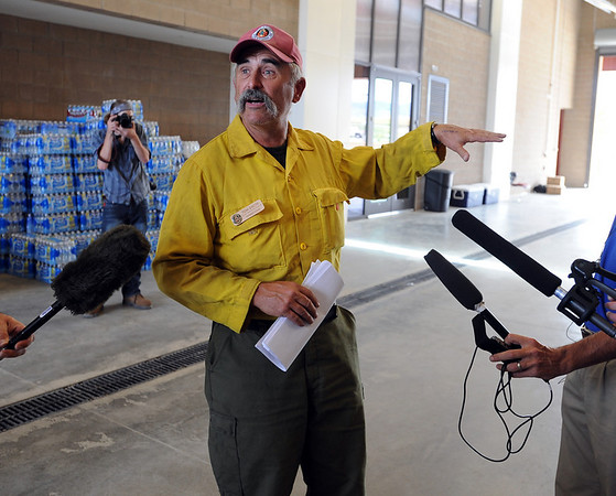 """Tom Smith is one of the commanders in charge of the fire fighters. He tells the media about the firefighters that lost their homes.<br /> For  videos relating to the fire,  go to  <a href=""""http://www.dailycamera.com"""">http://www.dailycamera.com</a>.<br /> Cliff Grassmick / September 8, 2010"""