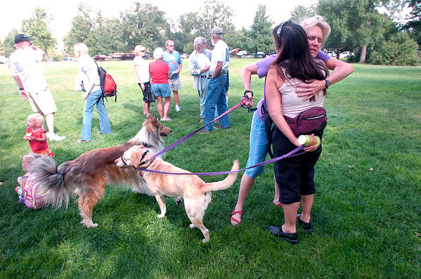 """Two women hug at the community gathering of Gold Hill evacuees at Chautauqua in Boulder on Wednesday morning. The women asked not to be identified but the women with her back to the camera is a resident of Gold Hill.<br /> For a video of the meeting go to  <a href=""""http://www.dailycamera.com"""">http://www.dailycamera.com</a><br /> Photo by Paul Aiken"""