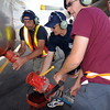 Retardant loading crew members, parking tender Mark VonAllman, left, Paul Swedhin and Will Leiningerremove the hose for loading retardant on to an airtanker to fight the Fourmile Canyon Fire in Boulder County at the US Forest Service Airtanker base at Rocky Mountain Metro Airport on Wednesday. <br /> <br /> September 8, 2010<br /> staff photo/David R. Jennings