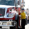 Ryan Knox (left), with East Grand Fire Rescue, opens his truck for Sage Somps (right), with American Medical Response, to do a vehicle inspection before the truck could be taken to the Fourmile Canyon fire in Boulder, Colorado September 8, 2010.  CAMERA/Mark Leffingwell