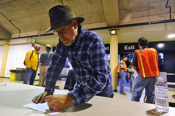 MEETING<br /> Clark Robertson, who was displaced from his home west of Gold Hill by the Fourmile Canyon Fire, fills out an evacuee form during a community meeting held Wednesday night at the Coors Event Center on the University of Colorado campus. <br /> Photo by Marty Caivano/Camera/Sept. 8, 2010