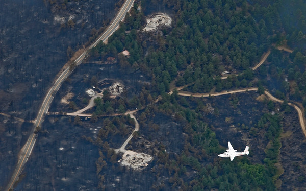 The command/control plane flies over part of the Fourmile Canyon fire, with three homes that were destroyed by the fire in Boulder, Colorado September 8, 2010.  CAMERA/Mark Leffingwell