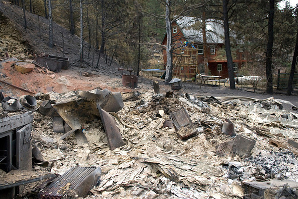 """A burned home seen next to a spared home in Fourmile Canyon on Wednesday September 8, 2010.<br /> Photos by Jeff Orlowski  <a href=""""http://www.jefforlowski.com"""">http://www.jefforlowski.com</a>"""