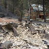 "A burned home seen next to a spared home in Fourmile Canyon on Wednesday September 8, 2010.<br /> Photos by Jeff Orlowski  <a href=""http://www.jefforlowski.com"">http://www.jefforlowski.com</a>"