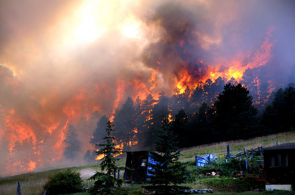 """Fire charges down the hill to Gold Hill as taken by photograper Greg Cortopassi at around 5:30 pm on Monday.<br /> Photos Greg Cortopassi <a href=""""http://cortoimages.com"""">http://cortoimages.com</a>"""