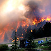 "Fire charges down the hill to Gold Hill as taken by photograper Greg Cortopassi at around 5:30 pm on Monday.<br /> Photos Greg Cortopassi <a href=""http://cortoimages.com"">http://cortoimages.com</a>"