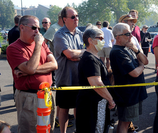 "Fire area residents and others listen to the  September 8, 2010 morning briefing by Boulder  County Sheriff's Cmdr.  Rick Brough,  concerning the latest from the Fourmile Fire.<br /> For  videos relating to the fire,  go to  <a href=""http://www.dailycamera.com"">http://www.dailycamera.com</a>.<br /> Cliff Grassmick / September 8, 2010"