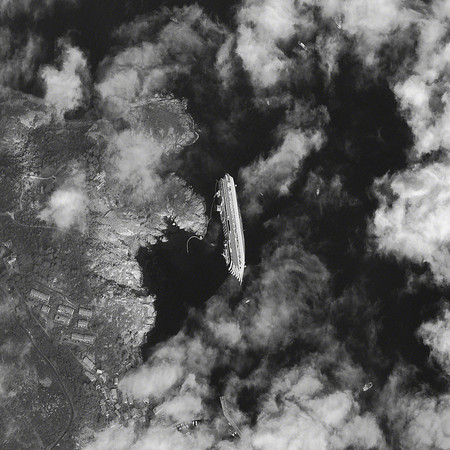 TCCRUISE.jpg DigitalGlobe took this satellite image of the capsized luxury cruise liner, the Costa Concordia, on Tuesday, Jan. 17. The ship ran around in the Tuscan waters off Giglio, Italy, on Friday, Jan. 13.