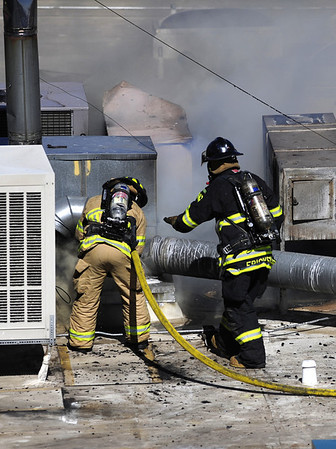 Firefighters work on the roof of a structure fire in Boulder Wednesday am.<br /> Photo by Mark Leffingwell