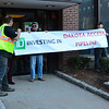 KRISTOPHER RADDER - BRATTLEBORO REFORMER<br /> Customers yell at Tim Stevenson and two others as they block the entrance to TD Bank on Main Street in Brattleboro, Vt., on Wednesday, Feb 22, 2017.