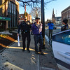 KRISTOPHER RADDER - BRATTLEBORO REFORMER<br /> Daniel Sicken is lead in handcuffs to a Brattleboro Police cruiser after he, Tim Stevenson, and Li Pon Owen barricaded themselves in the entryway of the TD Bank on Main Street in Brattleboro, Vt., on Wednesday, Feb 22, 2017.