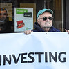 KRISTOPHER RADDER - BRATTLEBORO REFORMER<br /> Tim Stevenson and two others hold a sign about TD Bank investing in the Dakota Access Pipeline as they block the entrance to the bank during a protest at the Brattleboro, Vt., Main Street location on Wednesday, Feb 22, 2017.