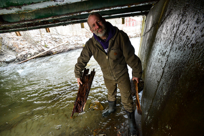 KRISTOPHER RADDER - BRATTLEBORO REFORMER<br />   Randy Bright, of Putney, holds pieces of the decking that fell off of the Old Stage Road bridge in Putney, Vt., on Tuesday, April 17, 2018.