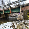 KRISTOPHER RADDER - BRATTLEBORO REFORMER<br /> Randy Bright, of Putney, looks at the damage at the Old Stage Road bridge in Putney  on Tuesday, April 17, 2018.