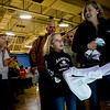 Children Hospital patient Tess Clark, 10, and her family walk through a tunnel of students during the Seventh Annual Dance Marathon for the Children's Hospital at the CU Recreation Center in Boulder, Saturday, Nov. 14, 2009. The 10-hour event included CU students who helped raise money for the Children's Miracle Network as well as the patients themselves.  <br /> <br /> KASIA BROUSSALIAN / THE CAMERA
