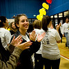 CU freshman Chloe Swenson (left) and sophomore Rebecca Ring cheer on the patients and their families during the Seventh Annual Dance Marathon for the Children's Hospital at the CU Recreation Center in Boulder, Saturday, Nov. 14, 2009. The 10-hour event included CU students who helped raise money for the Children's Miracle Network as well as the patients themselves.  <br /> <br /> KASIA BROUSSALIAN / THE CAMERA