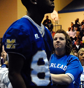 02-24-10  --bennett memorial service 02--  A McEachern cheerleader sheds tears as the Indians football team enters the Lovingood Gym for the Memorial Service for murdered football star Rajaan Bennett on Wednesday evening.  STAFF/LAURA MOON.