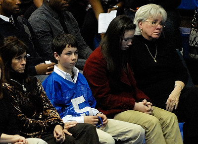 02-24-10  --bennett memorial service 17--  Bailey Hockman, 11, son of McEachern head football coach Kyle Hockman, wears the practice jersey of Rajaan Bennett as he sits with his mother Cindy Hockman, sister Savanna, 12, and grandmother Judy Hockman during the memorial service for the murdered football star.  STAFF/LAURA MOON.