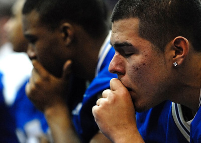 02-24-10  --bennett memorial service 06--  Members of the McEachern Indians football team show their emotions on Wednesday evening.  STAFF/LAURA MOON.