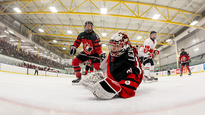 December 31, 2017 - Calgary, AB - Mac's Tournament Exhibition Hockey between Canada's National Women's Olympic Team and Hungary's National U18 Men's Team. Second period action in front of Hungary's net.