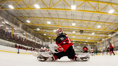 December 31, 2017 - Calgary, AB - Mac's Tournament Exhibition Hockey between Canada's National Women's Olympic Team and Hungary's National U18 Men's Team. Canada's goalie Geneviève Lacasse deflects a shot.