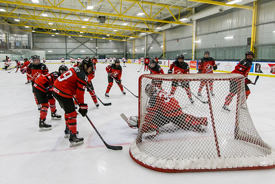 December 31, 2017 - Calgary, AB - Mac's Tournament Exhibition Hockey. Canada's National Women's Olympic Team and Hungary's National U18 Men's Team met for an exhibition game during the 2017-2018 Mac's AAA Midget Hockey Tournament held at the Max Bell Centre Arena's. Team Canada during pre-game warm-ups.