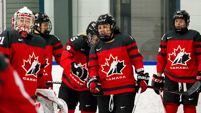 December 31, 2017 - Calgary, AB - Mac's Tournament Exhibition Hockey. Canada's National Women's Olympic Team and Hungary's National U18 Men's Team met for an exhibition game during the 2017-2018 Mac's AAA Midget Hockey Tournament held at the Max Bell Centre Arena's. Brigette Lacquette (center) during pre-game warm-ups.