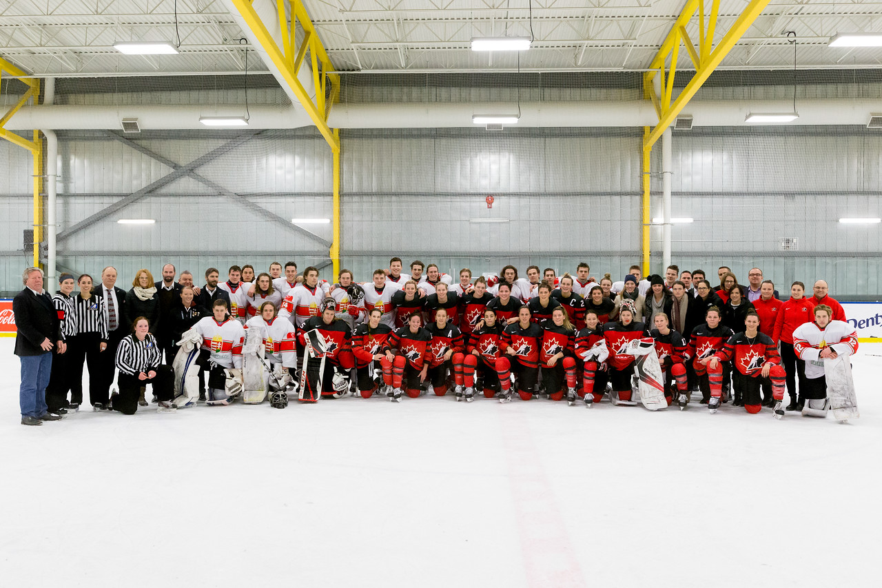 December 31, 2017 - Calgary, AB - Mac's Tournament Exhibition Hockey. Canada's National Women's Olympic Team and Hungary's National U18 Men's Team gather for post-game team photos at the conclusion of the game.