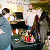 Tracy Teeter of Indianapolis, far right, shops at the Sage's Simple Syrups booth Saturday, Nov. 23, during the fourth annual Artisans' Fare at the SullivanMunce Cultural Center. Owners Bryna and Ryan O'Neill discuss options with Teeter.