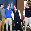 """Benjamin Knecht, Duke Schillaci, James Rausch, Michael Johnson, Connor Drake, and Christopher Arnold sing """"Winter Song"""" a cappella during the Zionsville Community High School Show Choirs' Carol of Homes Saturday, Dec. 6. The Royalaires singers were stationed at the home of the Lantz family, 120 S. Sixth St."""