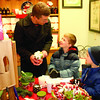 Tim White helps his sons, Nolan, 7, and Alex, 5, shop for Mom on Dads' & Kids' Night, Thursday, Dec. 18, at Butler's Pantry.