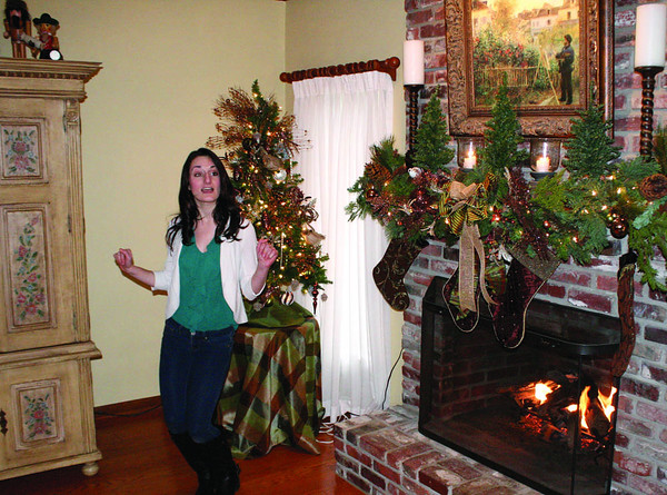 "Alexandra Yiannoutsos performs ""Jingle Bell Rock"" at the Hain home on Williamsburg Lane during Carol of Homes."