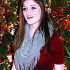"""Kara Bailey sings """"White Christmas"""" in front of the Christmas tree at the home of Karen and Sam Hain, on Williamsburg Lane."""
