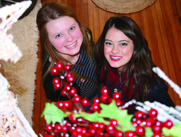 Not all show choir members performed during Carol of Homes Saturday. Anna Firmani and Bailee Dodson were greeters at the Lantz home.