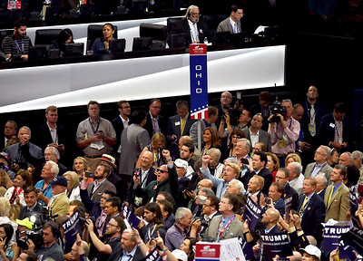 KRISTIN BAUER | GAZETTE Delegates from the state of Ohio cheer when over state's delegates pledged their votes to Govenor Kasich.