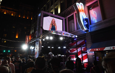 KRISTIN BAUER | GAZETTE East 4th St., in downtown Cleveland, was packed with scores of people who gathered to watch a live broadcast of Tiffany Trump addressing the delegates, guests and media gathered at the Quicken Loans Arena on the second night of th Republican National Convention.