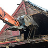 KRISTOPHER RADDER - BRATTLEBORO REFORMER<br /> Crews from Tom Call Excavation helps All Season Construction when it came to demolition of the building on 56 Elm St., in Brattleboro, on Tuesday, April 17, 2018.