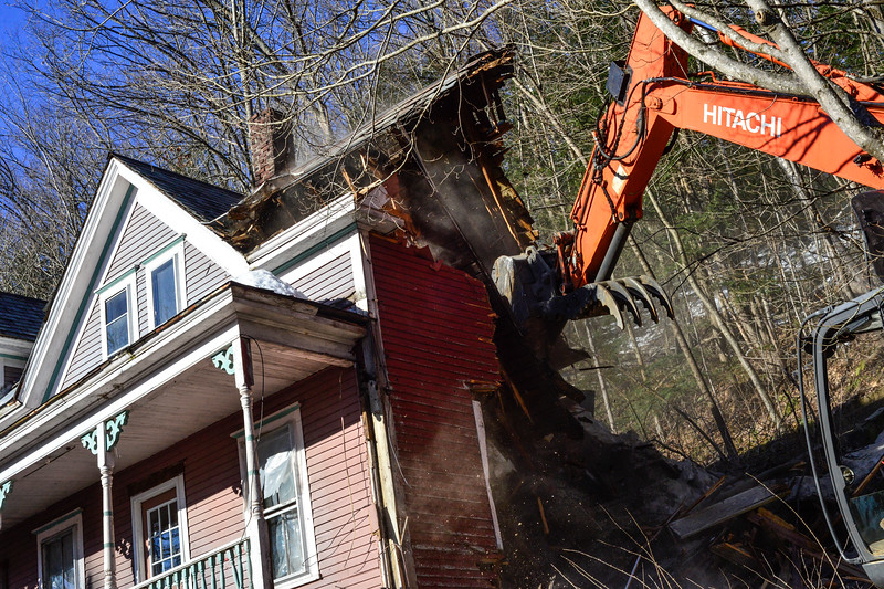 KRISTOPHER RADDER - BRATTLEBORO REFORMER<br /> Crews from Hodgkins and Sons demolish 42 Hyde Street in Bellows Falls on Monday, March 26, 2018.