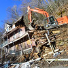 KRISTOPHER RADDER - BRATTLEBORO REFORMER<br /> Brad Benjamin operates the excavator during the demolition of 42 Hyde Street in Bellows Falls on Monday, March 26, 2018.