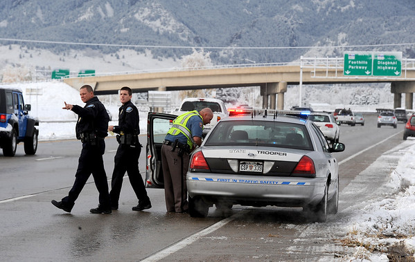 "Boulder Police officers stop traffic to go to another car involved in the accident.<br /> Icy roads caused a 5-car accident on the diagonal north of Boulder and south of Jay Road Thursday morning. There were no injuries reported.<br /> For a video and more photos, go to  <a href=""http://www.dailycamera.com"">http://www.dailycamera.com</a>.<br /> Cliff Grassmick  / October 25, 2012"