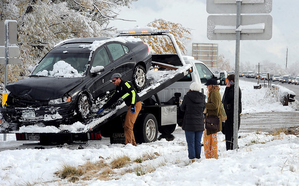 """Drivers of the cars involved in the diagonal accident  fill out accident reports while a driver from Marv's Towing pulls up one of the cars.<br /> Icy roads caused a 5-car accident on the diagonal north of Boulder and south of Jay Road Thursday morning. There were no injuries reported.<br /> For a video and more photos, go to  <a href=""""http://www.dailycamera.com"""">http://www.dailycamera.com</a>.<br /> Cliff Grassmick  / October 25, 2012"""