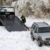 "A driver from Marv's Towing prepares a car for towing after the diagonal accident<br /> Icy roads caused a 5-car accident on the diagonal north of Boulder and south of Jay Road Thursday morning. There were no injuries reported.<br /> For a video and more photos, go to  <a href=""http://www.dailycamera.com"">http://www.dailycamera.com</a>.<br /> Cliff Grassmick  / October 25, 2012"